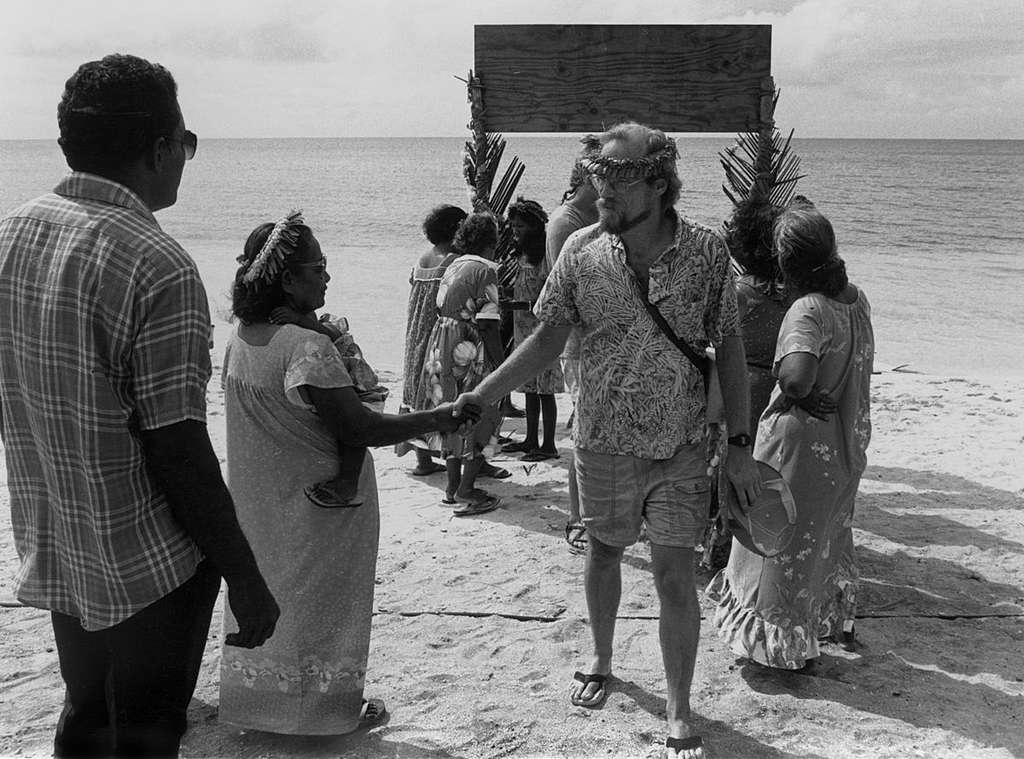 Campaigner Steve Sawyer, is welcomed by inhabitants from Rongelap. The Rainbow Warrior crew is evacuating Rongelap Islanders to Mejato. Rongelap suffered nuclear fallout from US nuclear tests done from 1946 – 1958, making it a hazardous place to live. The health of many adults and children has suffered as a result. The Greenpeace crew took adults, children and 100 tonnes of belongings onboard.
