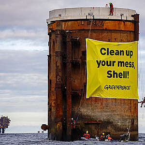 Greenpeace activists board Shell oil rigs in protest against plans to leave behind oil in the North Sea
