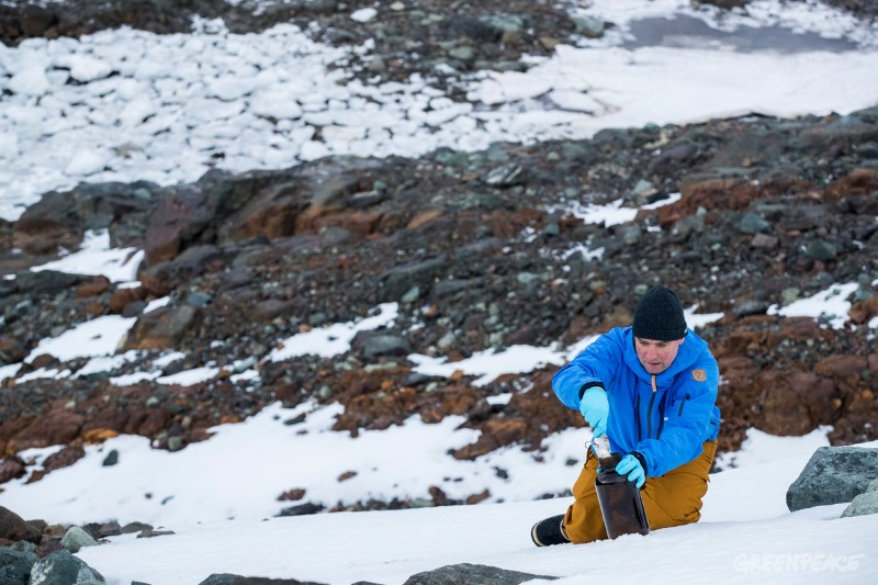 Campaigner Thilo Maack takes snow samples, for testing of environmental pollutants, Greenwich Island, Antarctic, 24th March 2018. An international Greenpeace team is on an expedition to document the Antarctic's unique wildlife, to strengthen the proposal to create the largest protected area on the planet, an Antarctic Ocean Sanctuary. Photo: Paul Hilton /Greenpeace