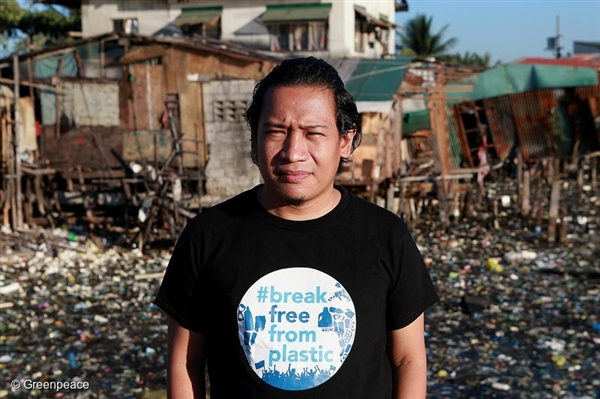 Global Anti Incineration Alliance Philippines Executive Director Froilan Grate stands in front of a trash-filled river in Barangay Bagumbayan North in Navotas City, Philippines.