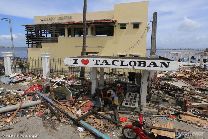 A family takes a rest under a waiting shed in Tacloban City after it was hit by Typhoon Haiyan last Saturday.