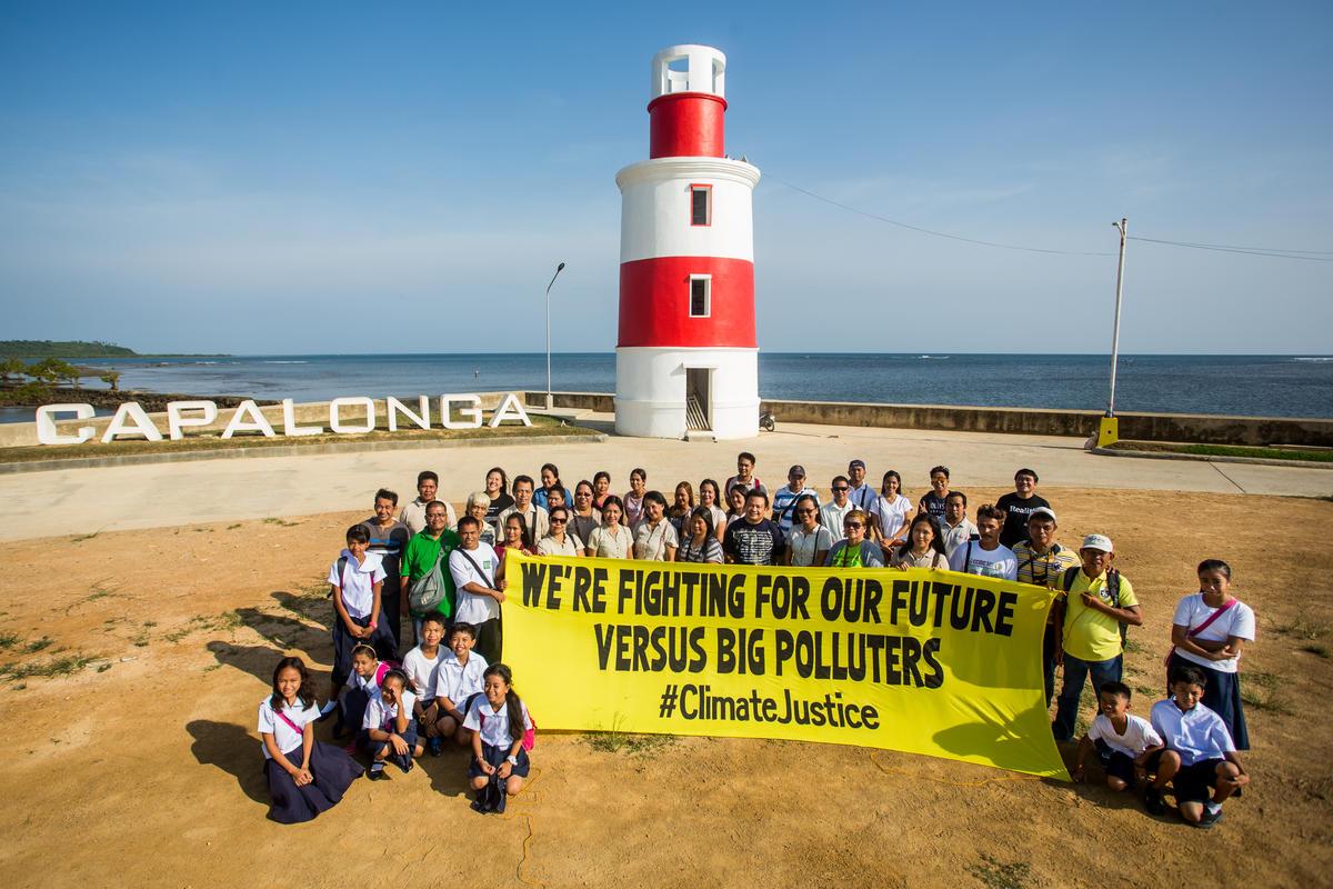 Climate Justice Photo Activity in Capalonga. © Greenpeace / Geric Cruz