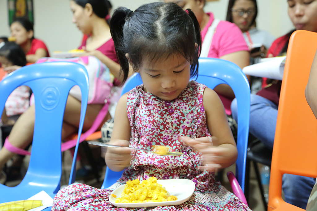 Young girl eating mac & squash