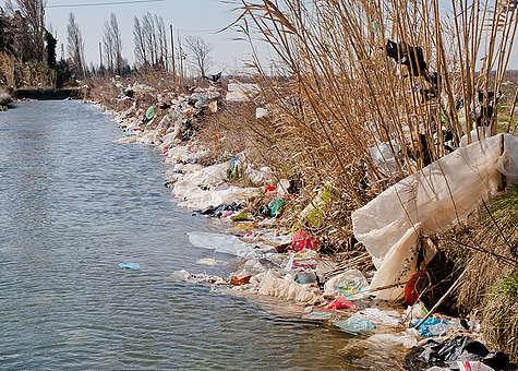 Plastic Waste Blown Away from Waste Landfill La Crau in France. © Wolf Wichmann / Greenpeace