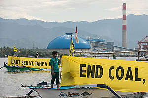 Rainbow Warrior Rejecting Coal Power Plant in Northern Bali. © Made Nagi / Greenpeace