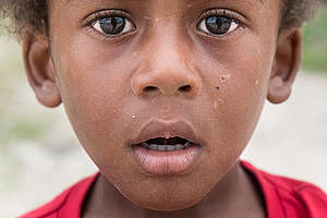 Child in Takara Village. © Pedro Armestre / Greenpeace