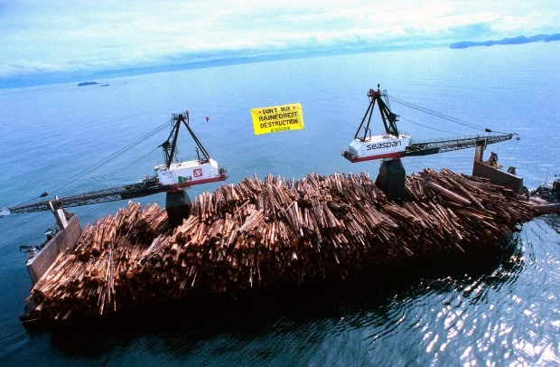 Greenpeace occupy log barge