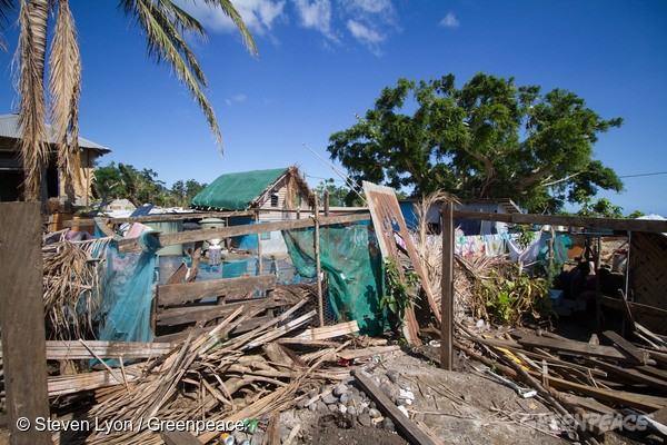 21st May 2015. Tanna Island, Vanuatu. Houses and structures on the Island show the damage from the Cyclone.The Rainbow Warrior anchors offshore while RHIBs (Rigid-hulled Inflatable Boats) deliver goods to the outer Island of Vanuatu. Extreme weather events, such as Cyclone Pam, threaten to become the new normal for Pacific island states as the global climate changes, underscoring the urgency to cut global emissions to avert a climate crisis.