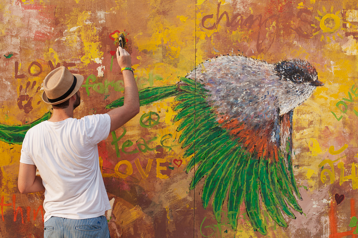 Man Paints at Wonderfruit Festival in Thailand. © Antolin Avezuela / Greenpeace