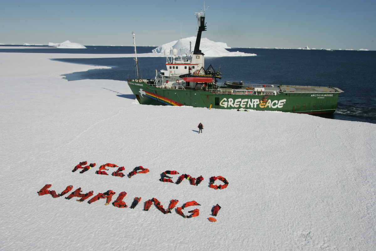 Crews form message with their bodies - Southern Ocean Tour 2005 - Sutton-Hibbert. © Greenpeace / Jeremy Sutton-Hibbert