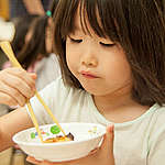 Child Eating Ecologically Sourced Lunch at Kindergarten in Japan. © Kayo Sawaguchi / Greenpeace