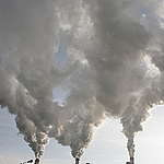 Smoke Belching from the Patnów Coal Plant's Chimney in Poland. © Greenpeace / Nick Cobbing