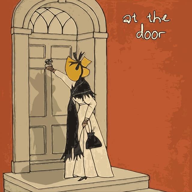 Couverture de At the Door