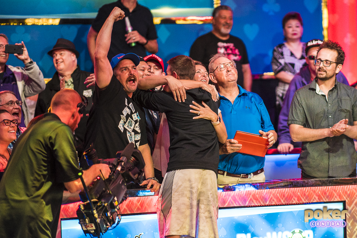 Supported by friends and family that stood with him through dark times, Tony Miles celebrates on the final table bubble.