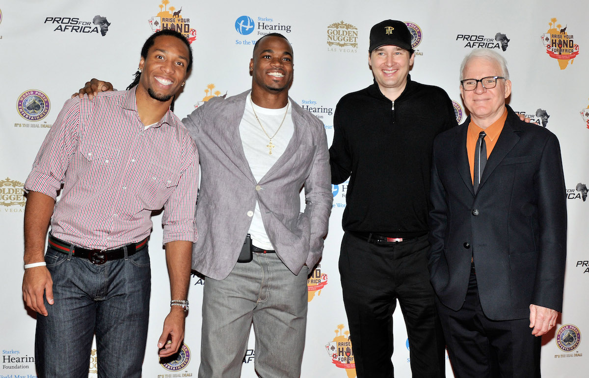 Phil Hellmuth and charity poker tournaments go way back! Here he's seen with Larry Fitzgerald, Adrian Peterson and Steve Martin at the 2011 'Raise Your Hand for Africa' at the Golden Nugget in Las Vegas. (Photo: GettyImages)