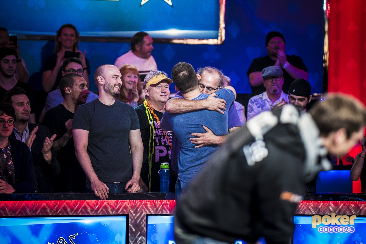 Justin Bonomo hugs his father after winning the Big One for One Drop.
