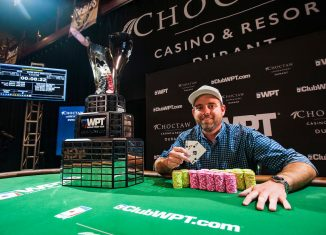 Brady Holiman holding up the winning hand after taking down WPT Choctaw earlier this season. (Photo: Pokerphotoarchive.com/Joe Giron)