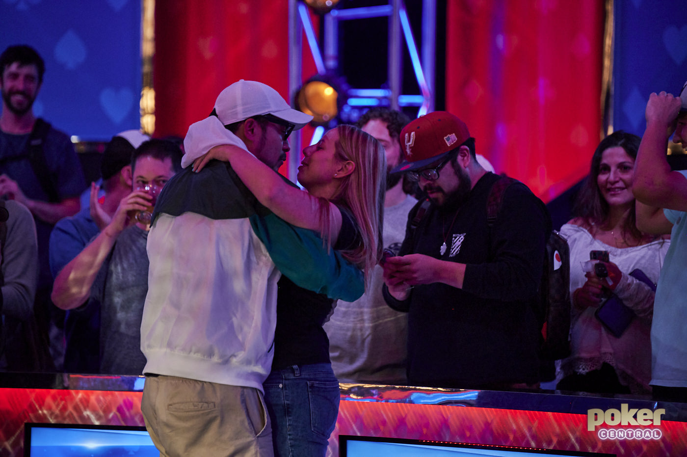 Phil Hui and his long-time girlfriend Loni Harwood share an intimate moment right after the final hand.