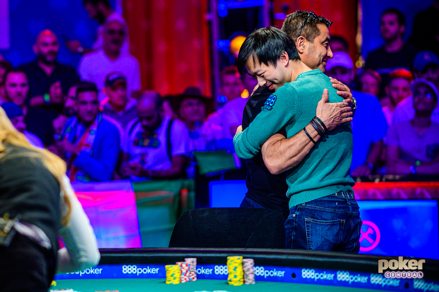 Timothy Su hugs Hossein Ensan after getting eliminated in 8th place for $1,250,000.