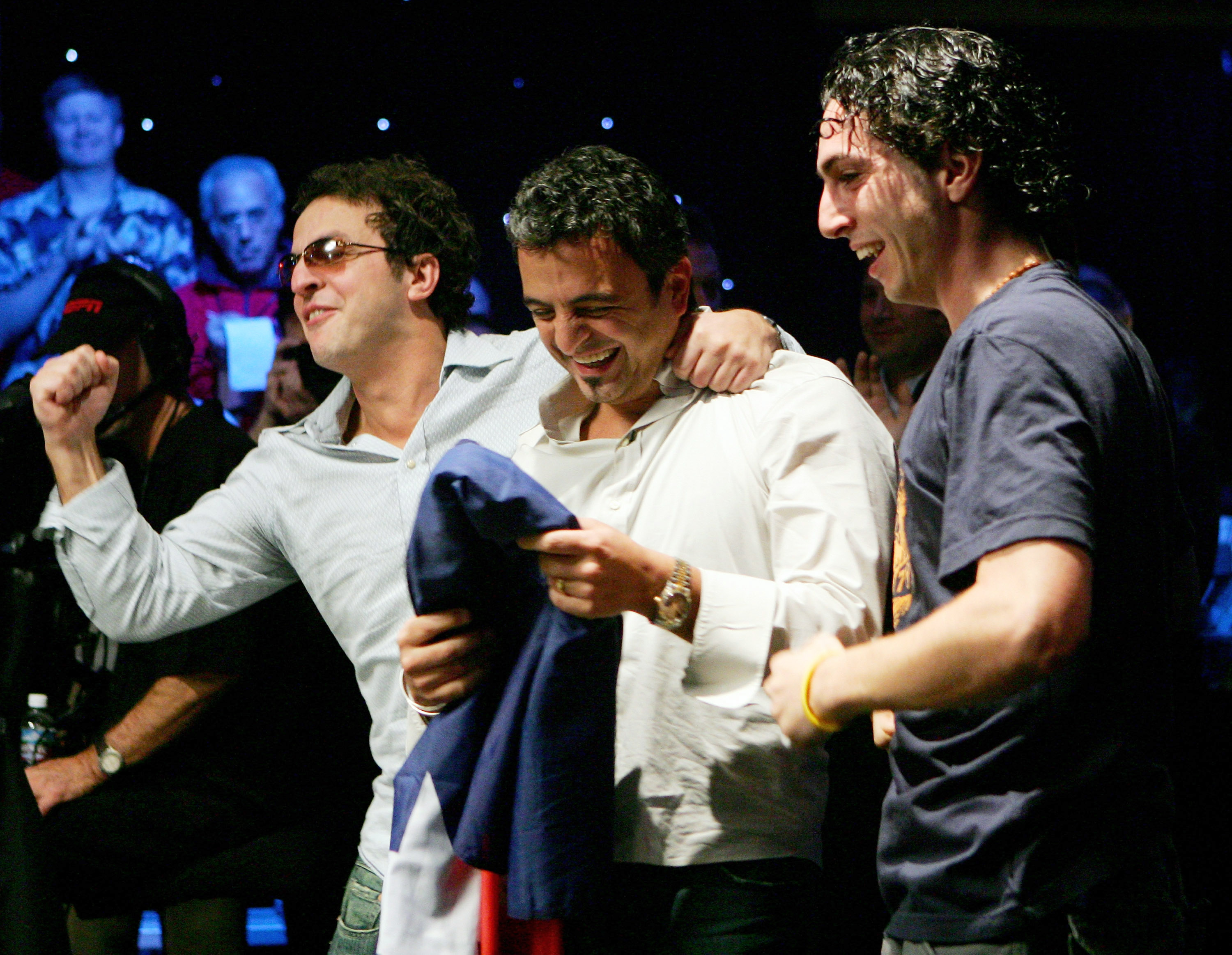 Joe Hachem celebrates his 2005 WSOP Main Event win with his brother Tony and cousin Billy Sukkar. (Image: Getty)