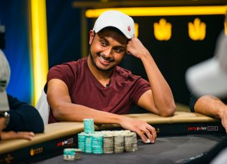 Vivek Rajkumar had plenty of reason to smile during Day 2 of the Triton Million! (PokerPhotoArchive.com/Joe Giron)