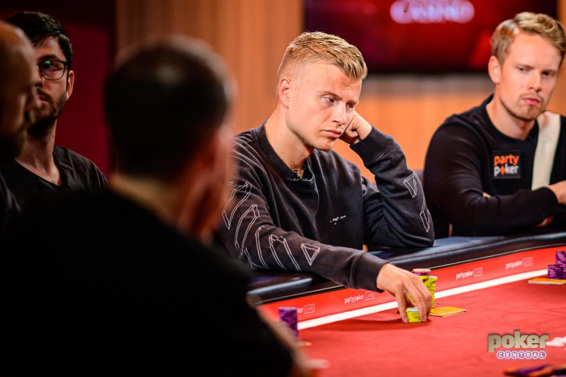 Jens Kyllonen flanked by Joni Jouhkimainen at the final table of the £10,000 Pot Limit Omaha event at the British Poker Open.