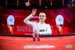 Mikita Badziakouski throws his winning cards in the air after winning Event #9 of the British Poker Open.