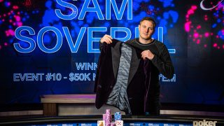 Sam Soverel showing off the Poker Masters Purple Jacket after a truly historic performance inside the PokerGO Studio.