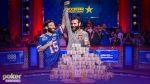 Dan Bilzerian holds up Dan Bilzerian's arm in defeat at the World Series of Poker Main Event final table!