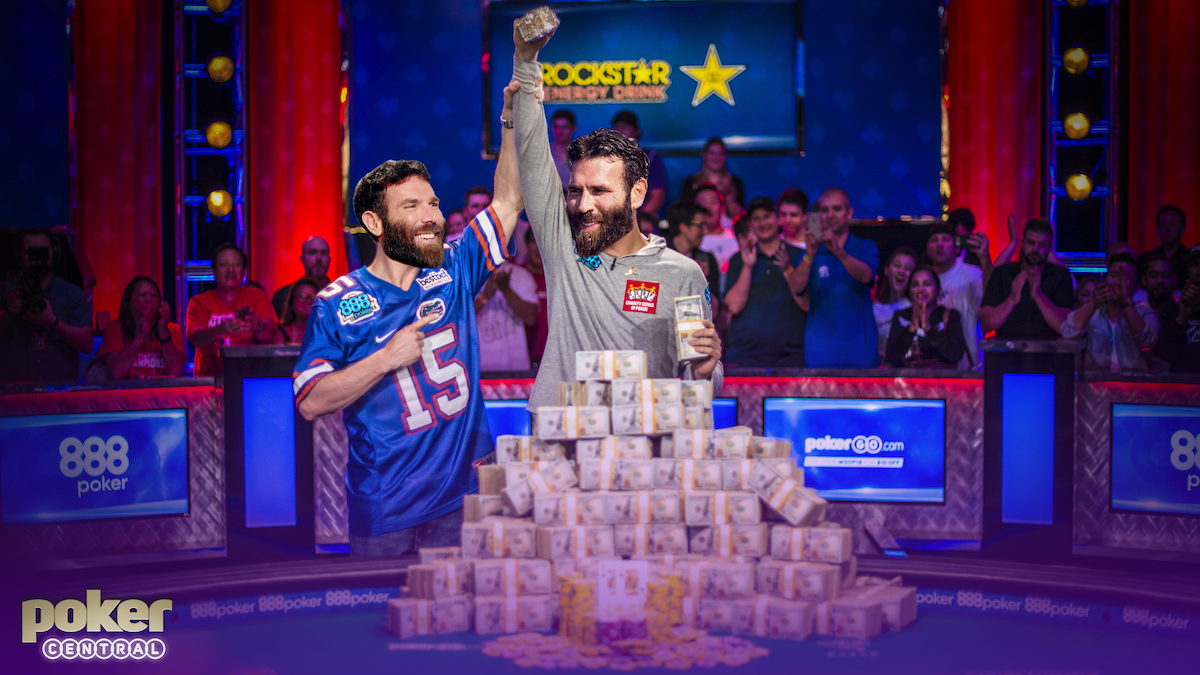 Dan Bilzerian holds up Dan Bilzerian's arm in defeat at the World Series of Poker Main Event final table!