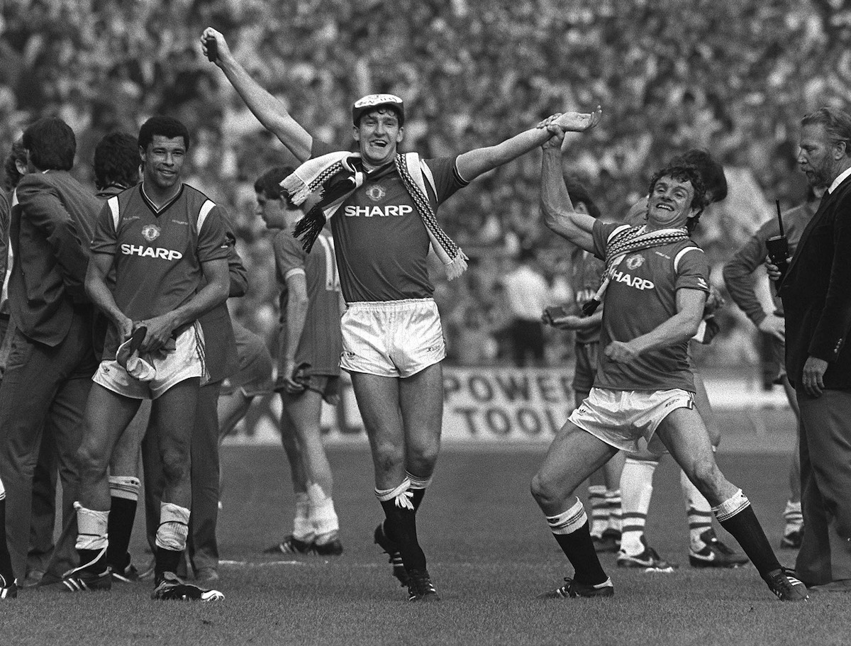 18/5/1985 FA Cup Final. Everton v Manchester United, Kevin Moran holds aloft the arm of United match-winner Norman Whiteside. (Photo by Mark Leech/Getty Images)