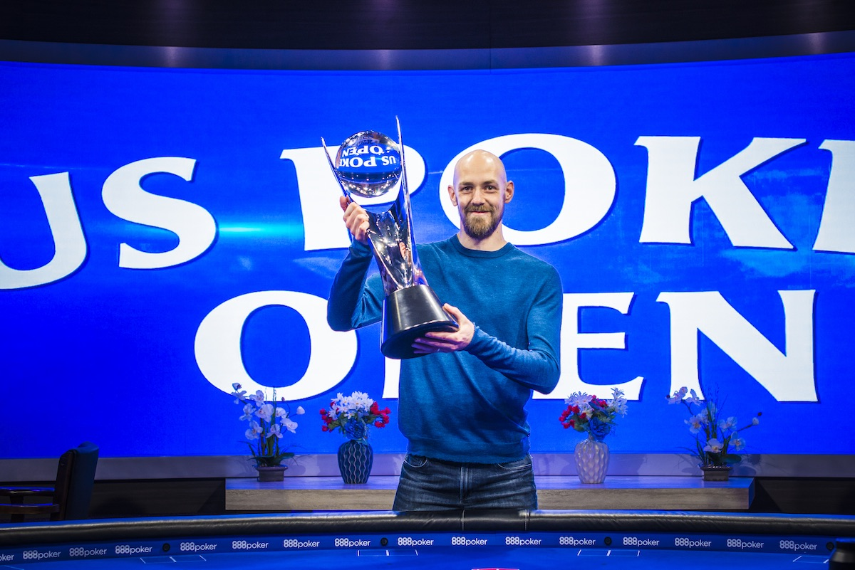 Stephen Chidwick proudly hoists the biggest trophy of his live poker career at the 2018 U.S. Poker Open.