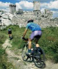 In Poland, you can enjoy biking among historical ruins and a beautiful nature.
