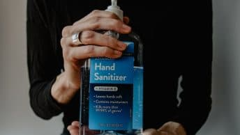 woman holding hand sanitizer