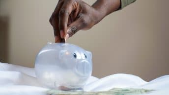 putting money in piggy bank