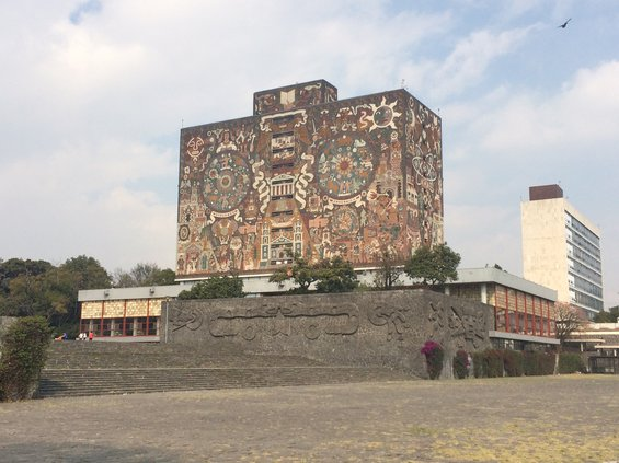 View of the National Autonomous University of Mexico Library, its outer surfaces covered in a mural by Mexican artist, Juan O'Gormon.