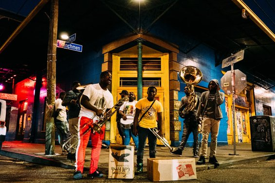 Musicians playing on a street corner at night