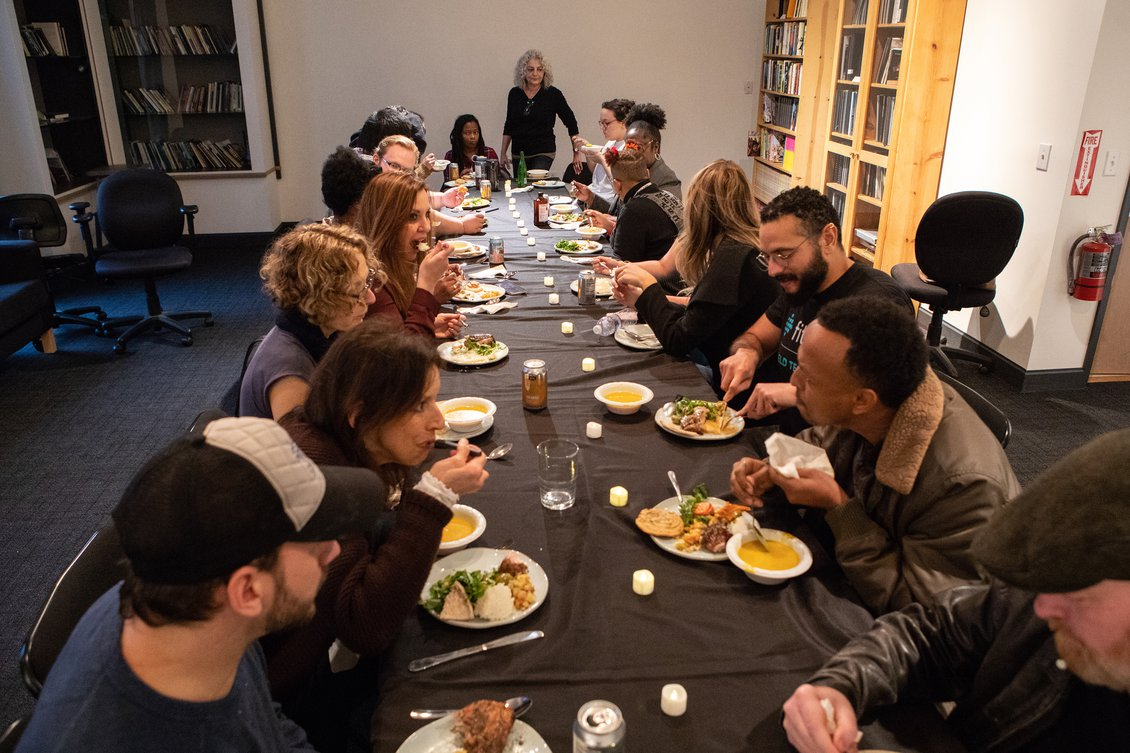 Writers taking time to eat together at a Tuesday potluck.
