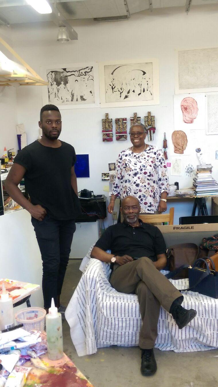 Proud father with Tunji his son and his wife, Buki