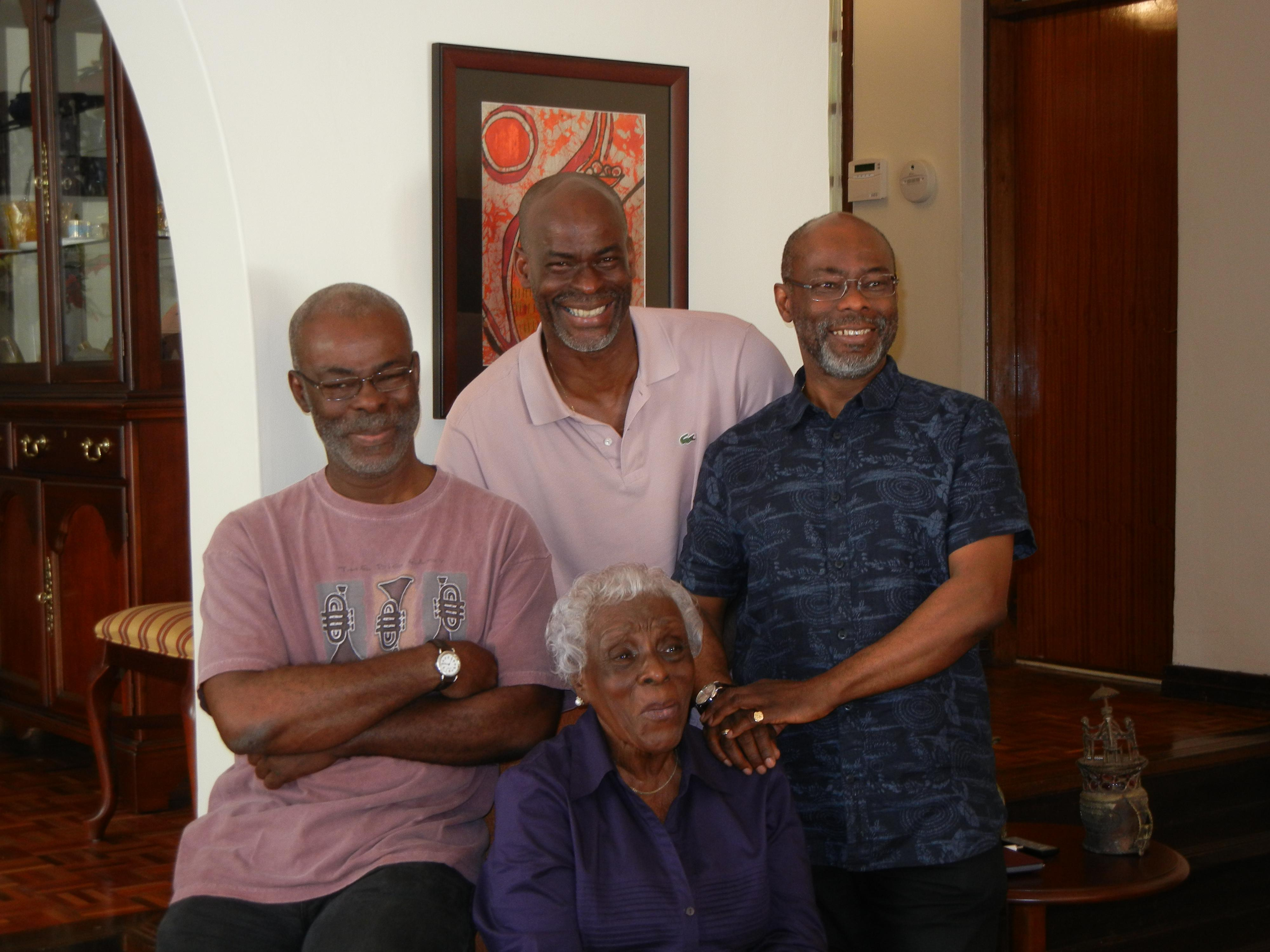 A family portrait - Jide, Richard and Rodney Adeniyi-Jones with their mother, the vibrant Olga Miller