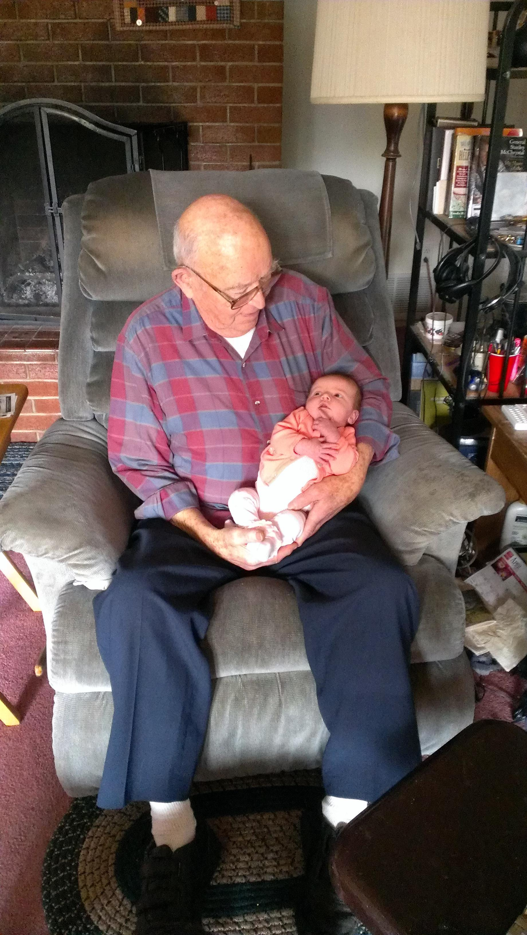 Grampa meeting his great granddaughter, Cecelia Carol for first time.