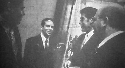 A Providence Journal photo of Nicholas Alahverdian, age 14, outside the House Chamber, with Sen. John Tassoni, Rep. Paul Moura, and Rep. Frank Montanaro, as he lobbied for more state aid to local schools