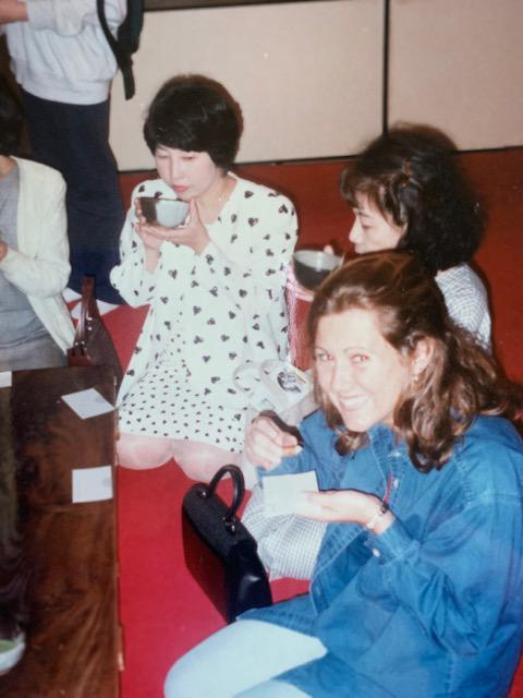 "Gina wrote on the pack of this photo: ""Gina participating in a Japanese tea ceremony at a Zen Temple in Kyoto (you can see I did it backwards and was frowned upon by the other ladies :("""