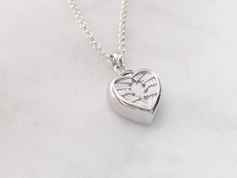 Photo of Sterling Silver Winged Heart Cremation Urn Necklace
