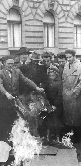 Second from the right is my father, burning an image of Starlin in the 1956 Hungarian uprise