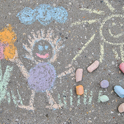 Chalk drawing on pavement by child