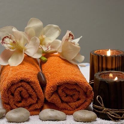 Massage Therapy Candles, Towels and Stones