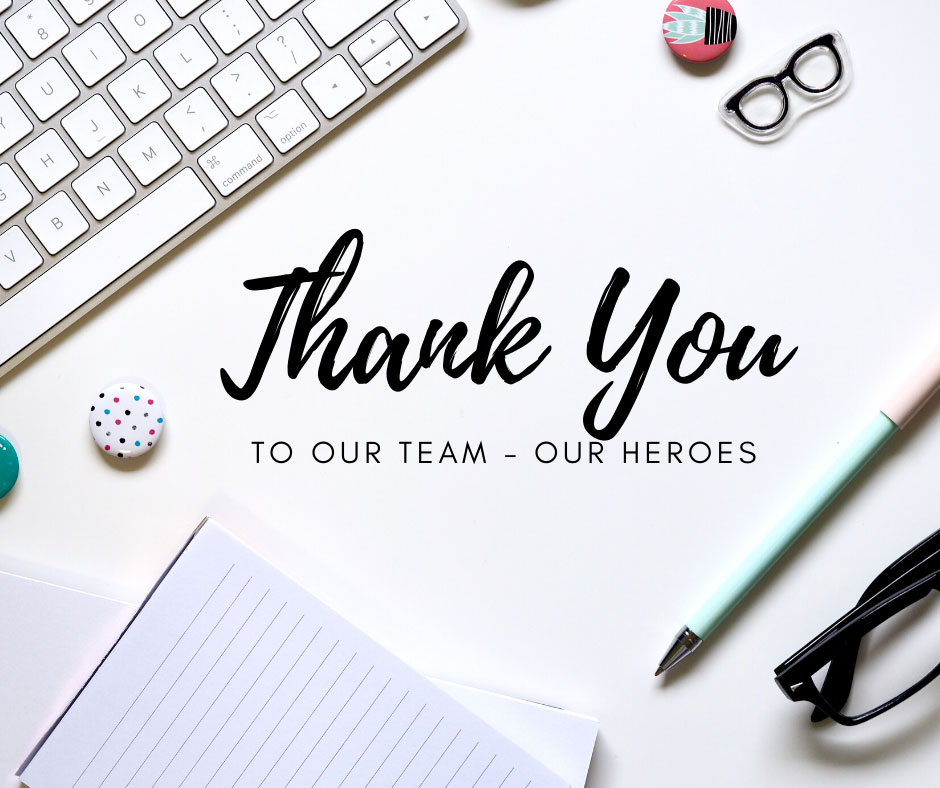 a photo of a keyboard and a pad of paper with text overlay that says thank you to our team our heroes