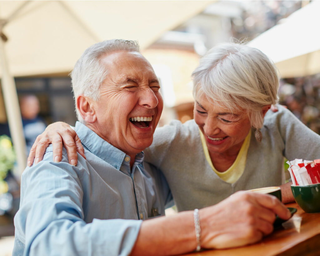 a senior couple laughing