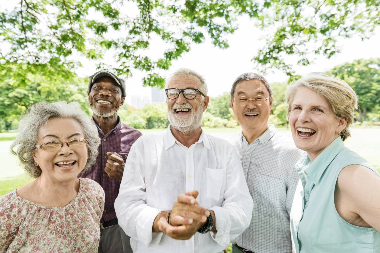 A group of seniors pose for a photo in a park near downtown Chicago